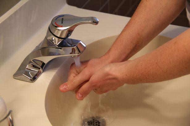 Washing hands, Moen faucet